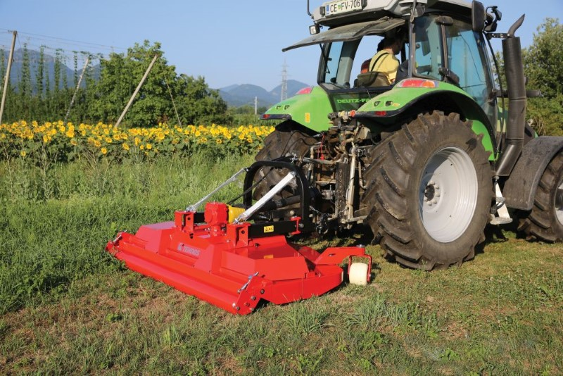 Finishing mowers are attached behind a tractor